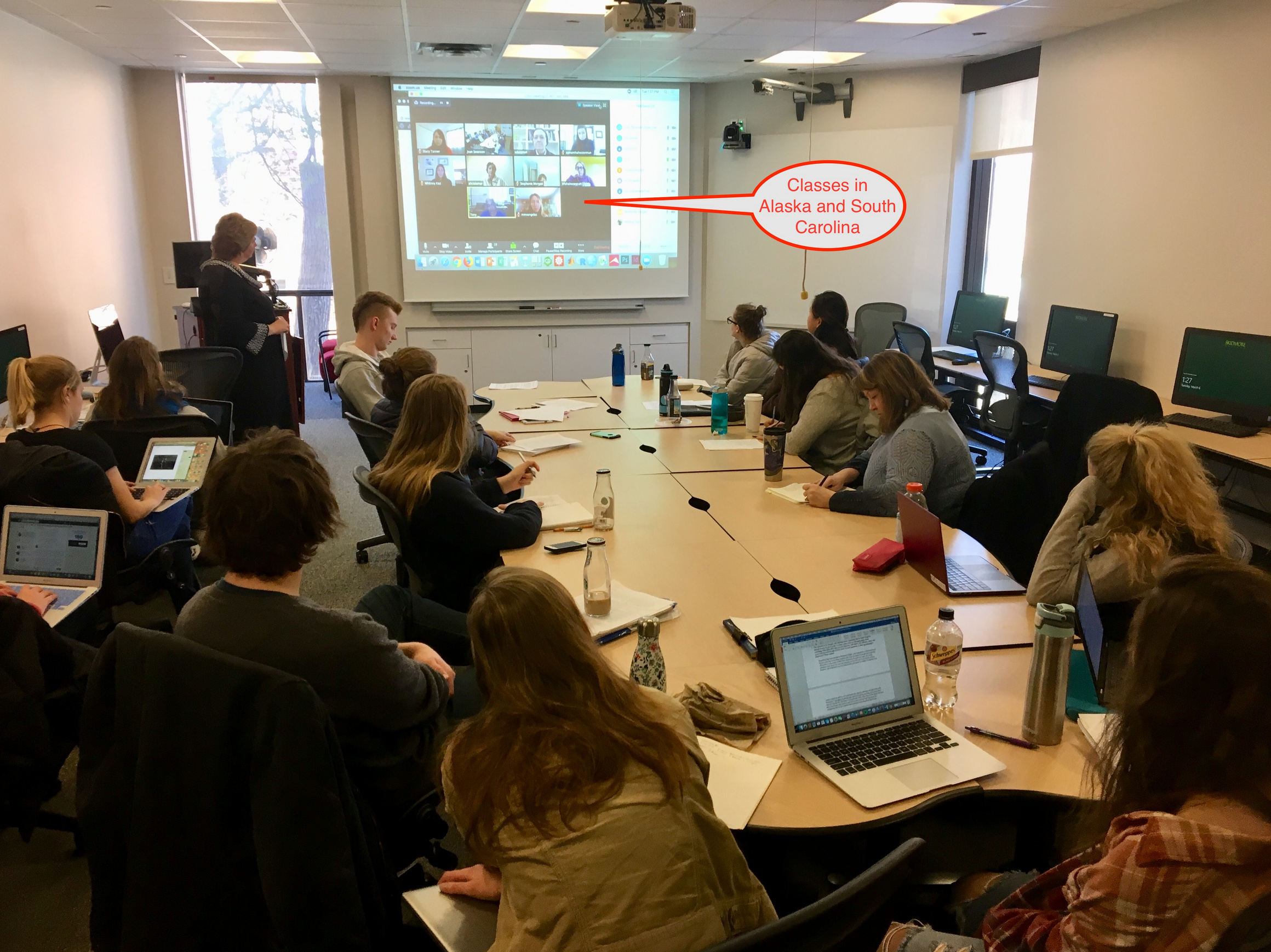 Students connect with many different parties at once, including students in Alaska and South Carolina, over video-communication in real time.