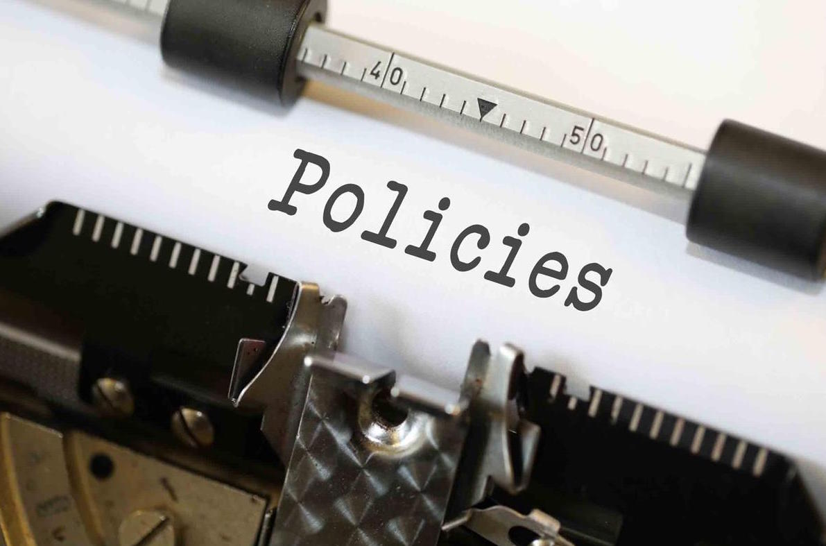 Stock image of policies on a typewriter