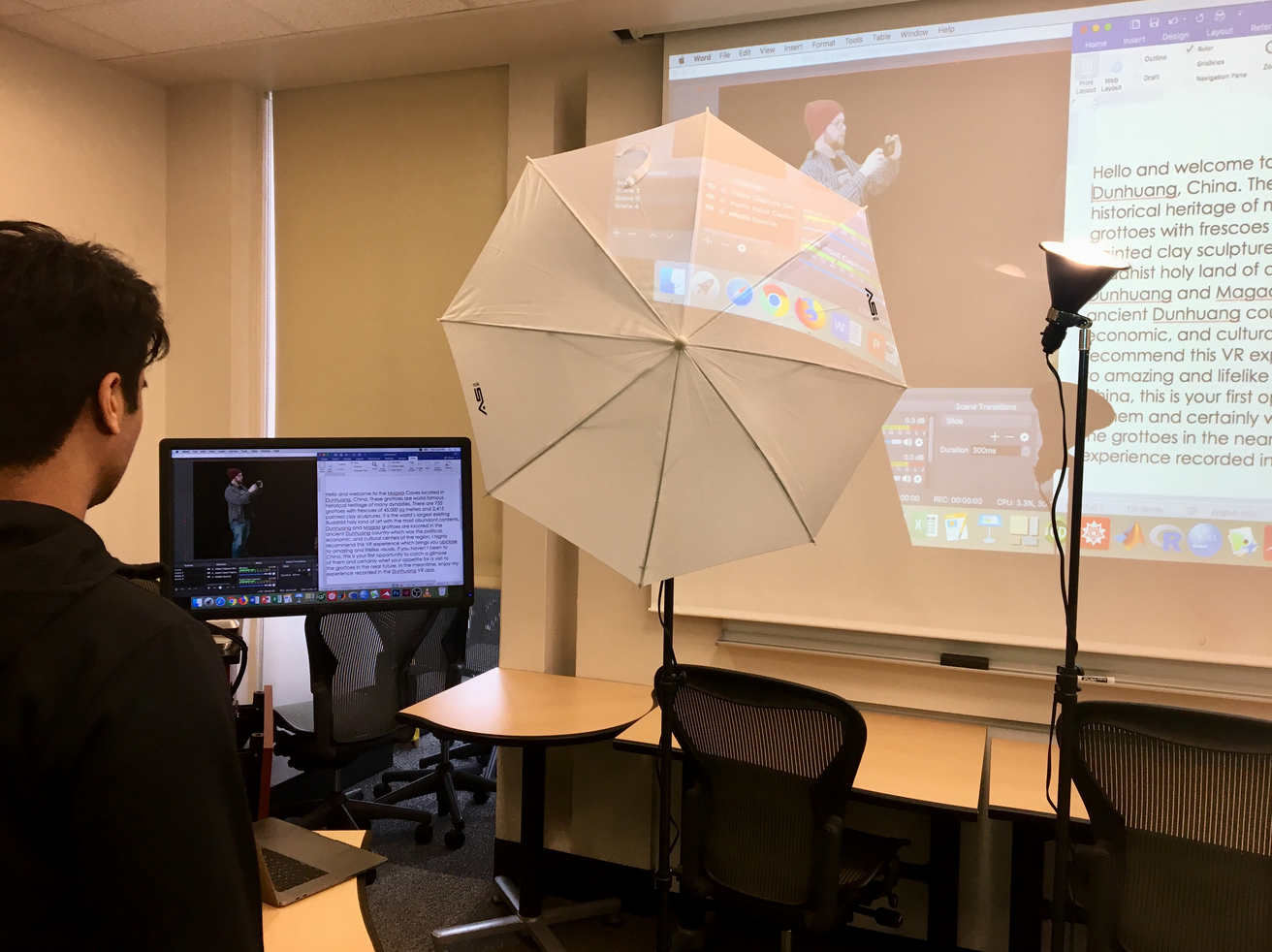 A LEDS assistant prepares lighting and visual resources for a presentation.
