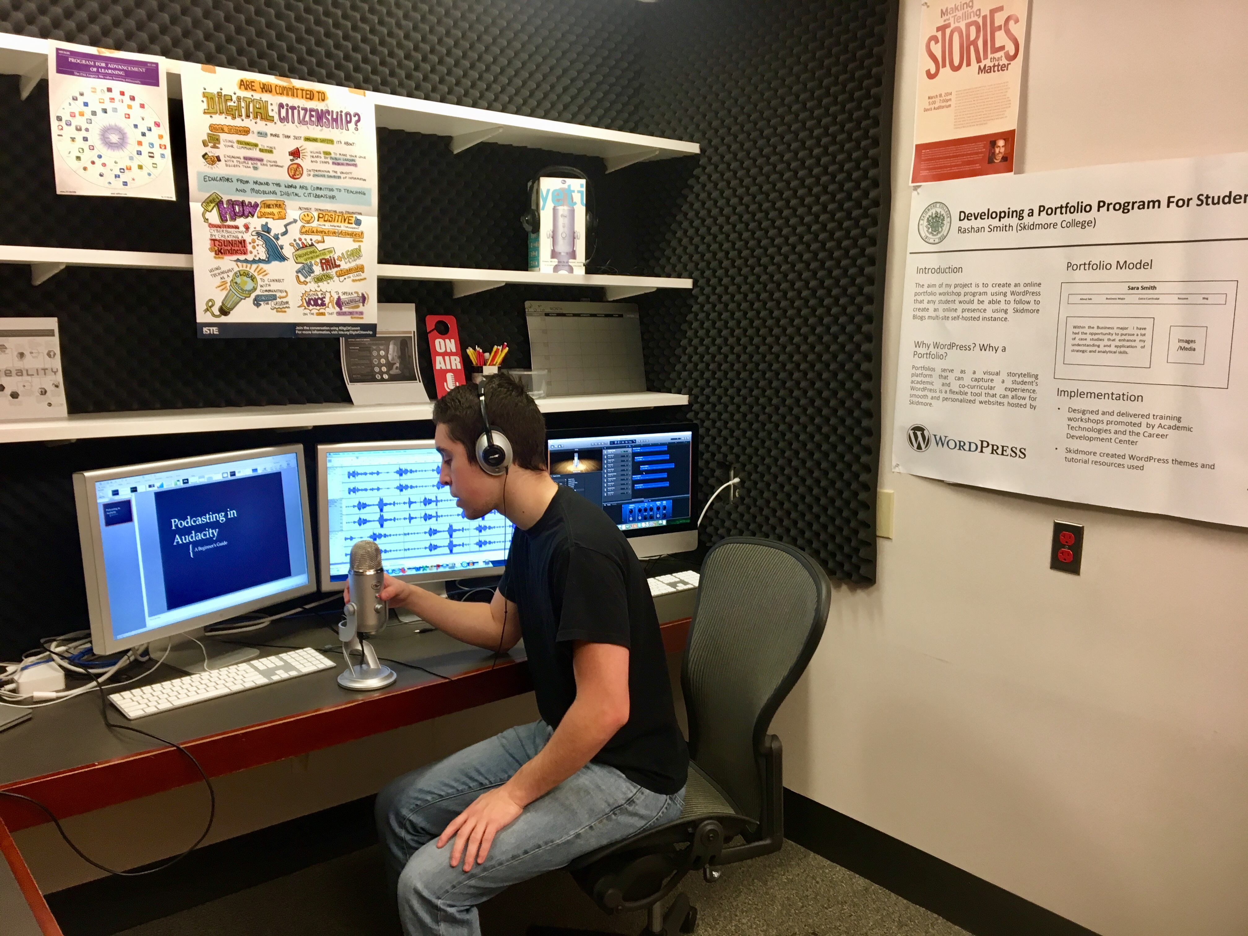 A student records voiceover in the LEDS podcasting space.